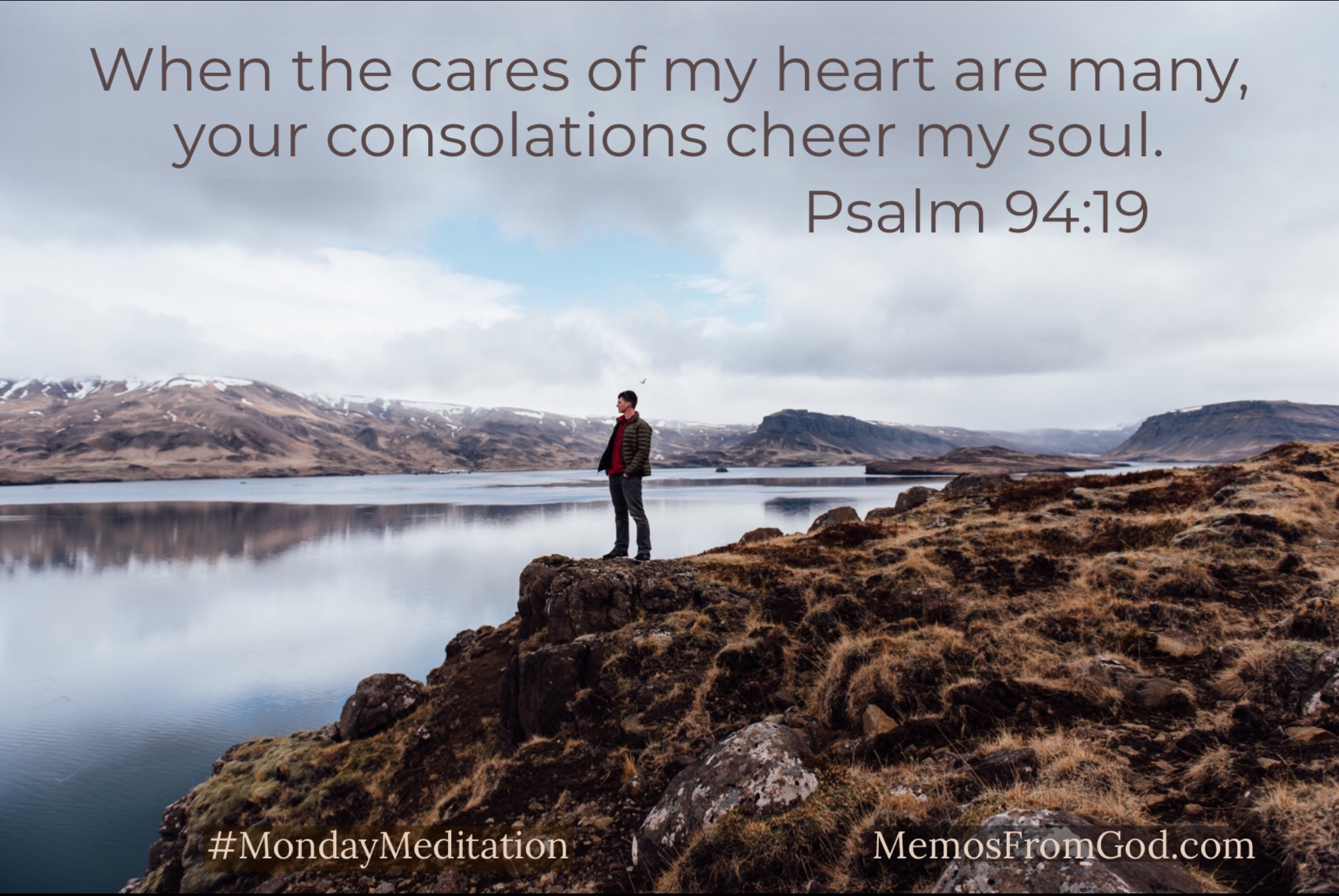 A man standing on a rocky shore looking out over calm water. Caption: When the cares of my heart are many, your consolations cheer my soul. Psalm 94:19