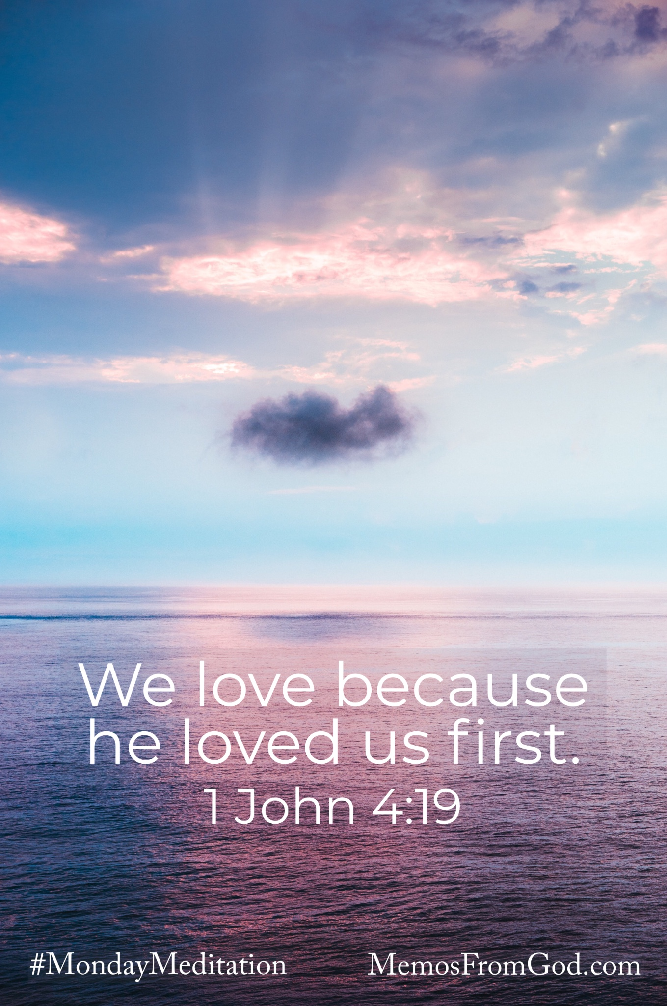 A body of water reflecting the blue and purple sky with the shadow of one small, dark cloud below the rays of sun shining through a brighter cloud. Caption: We love because he loved us first. 1 John 4:19