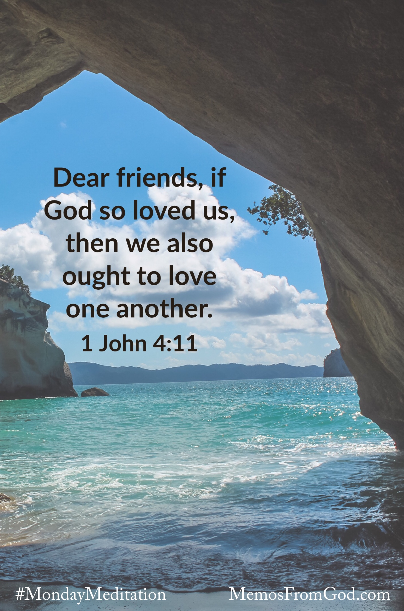 Looking through a natural stone archway to teal water with mountains on the horizon. Caption: Dear friends, if God so loved us, then we also ought to love one another. 1 John 4:11